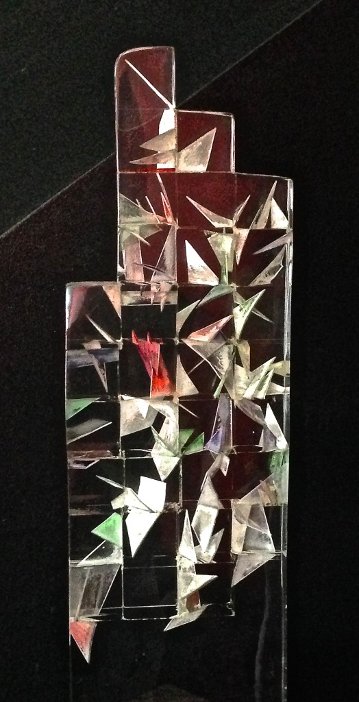 A crystal sculpture with colorful origami inside. Very cool!